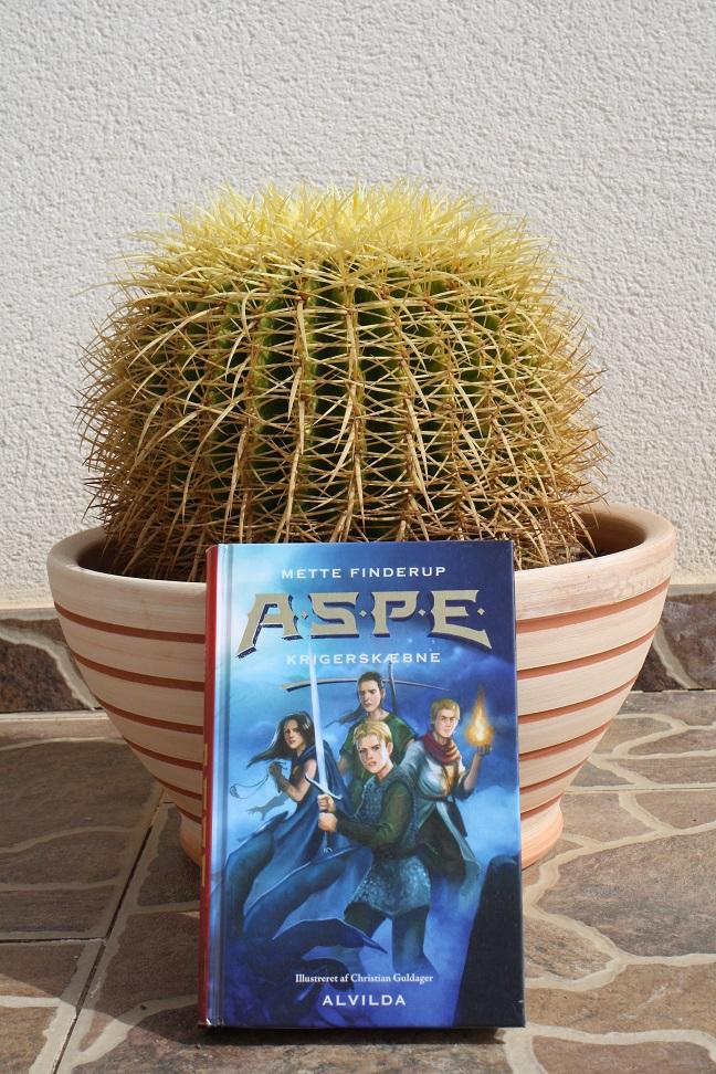 """Billede af Mette Finderups bog """"A.S.P.E. 2: Krigerskæbne""""."""
